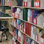 Bookshelves in the library, each shelf full of colorful books